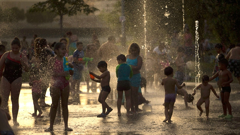 People try to cool off in public fountain at the Madrid Rio area during a hot summer day in Madrid, Thursday, July 13, 2017. (AP /Francisco Seco)