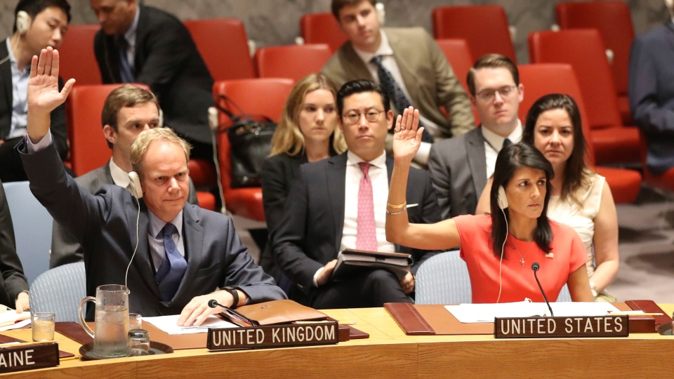 British Ambassador to the United Nations Matthew Rycroft, left, and American Ambassador to the United Nations Nikki Haley vote during a Security Council meeting on a new sanctions resolution that would increase economic pressure on North Korea to return to negotiations on its missile program, Saturday, Aug. 5, 2017 at U.N. headquarters. (Mary Altaffer/AP Photo)