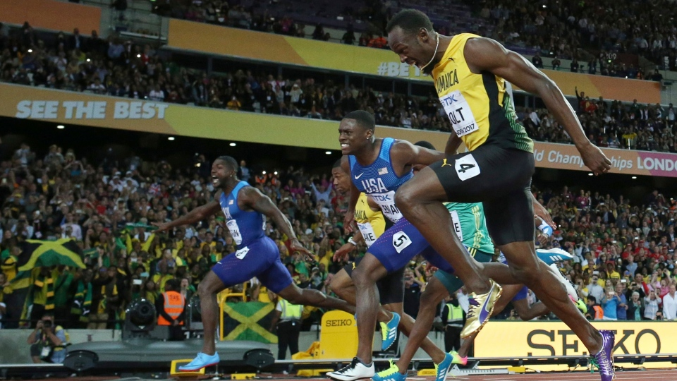 United States' Justin Gatlin, left, crosses the line to win gold ahead of silver medal winner United States' Christian Coleman, second right, and bronze medal winner Jamaica's Usain Bolt, right, in the men's 100-meter final during the World Athletics Championships in London Saturday, Aug. 5, 2017. (AP Photo/Matt Dunham)