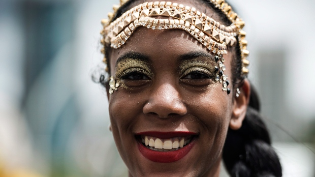 A parade participant performs during the Grand Parade at the Caribbean Carnival in Toronto on Saturday, August 5, 2017. THE CANADIAN PRESS/Christopher Katsarov