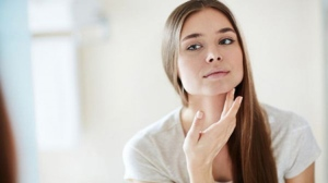 Face yoga can aid lymphatic drainage and reduce the appearance of under-eye circles. shironosov / Istock.com