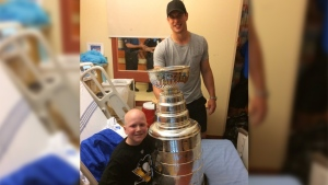 Sidney Crosby poses with the Stanley Cup and a patient at a Halifax children's hospital. (Philip Pritchard / Twitter)