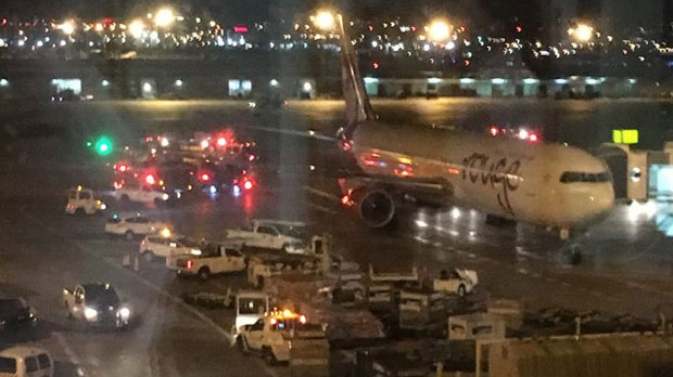 A passenger on the LOT Polish Airlines plane took this photo from the airport the night of the incident. (Source: Ari Silecky)