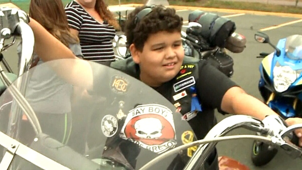 10-year-old Xander Rose sits on a motorcycle near Sydney, N.S. (CTV Atlantic)