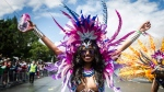 Parade participants perform during the Grand Parade at the Caribbean Carnival in Toronto on Saturday, August 5, 2017. THE CANADIAN PRESS/Christopher Katsarov