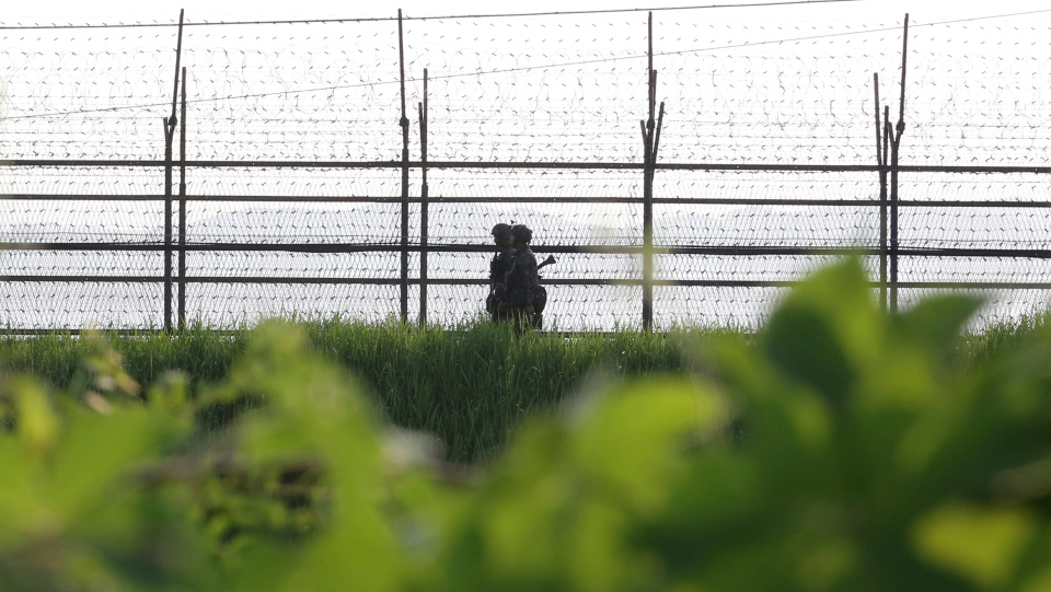 South Korean army soldiers patrol along the barbed-wire fence in South Korea's Paju, near the border with North Korea, Monday, Aug. 7, 2017. (AP Photo/Ahn Young-joon)