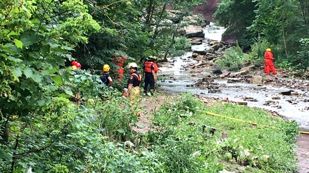Emergency officials are seen conducting a rope rescue at a Hamilton waterfall.