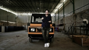 Egyptian entrepreneur Ahmed Saeed el-Feki, who hopes to reshape the country's auto-mobile industry with his new minicar, poses for a photograph inside a workshop in the village of Kerdasa, not far from the Giza Pyramids, greater Cairo, Egypt on Tuesday, Aug. 1, 2017. (AP / Nariman El-Mofty)