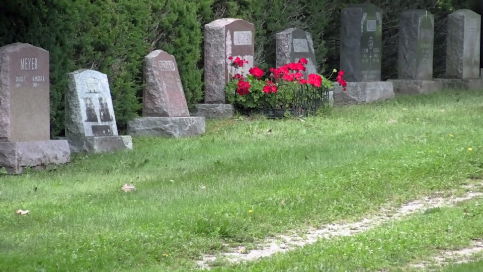 Headstones are seen in a cemetery in Waterloo on Tuesday, Aug. 8, 2017.