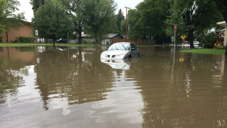 A car sits stuck at an intersection on Louise Street in Saskatoon as heavy rain causes flash flooding in the city Tuesday, Aug. 8, 2017. (Chad Hills/CTV Saskatoon)
