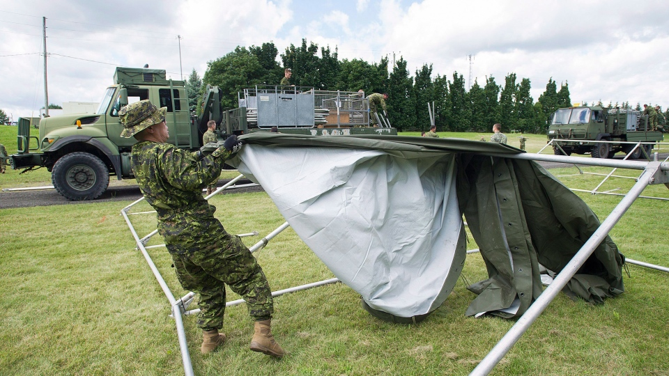Troops building tents