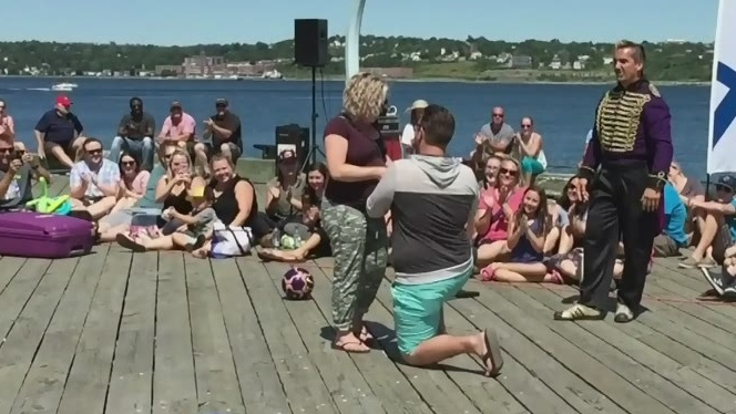 A video of a man Shane Borque proposing to his very pregnant girlfriend at the Halifax international Buskers Festival has gone viral.