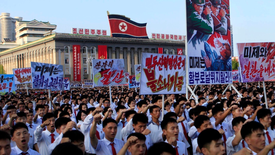 Tens of thousands of North Koreans gathered for a rally at Kim Il Sung Square carrying placards and propaganda slogans as a show of support for their rejection of the United Nations' latest round of sanctions on Wednesday Aug. 9, 2017, in Pyongyang, North Korea. (AP / Jon Chol Jin)
