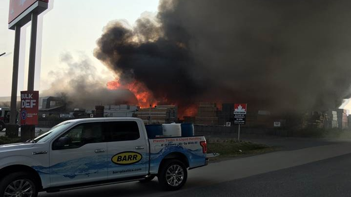 A large fire burning near Highway 1 in Abbotsford is seen on Wednesday, Aug. 9, 2017. (Kevin Macdonald)
