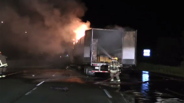 A tractor trailer slammed into two cars, crushing both.