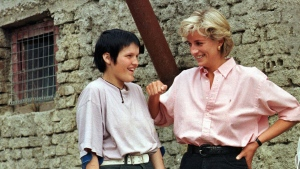 Diana, Princess of Wales, right, chats with Bosnian girl Mirzeta Gabelic, a 15 year-old landmine victim, in front of Mirzeta's home in Sarajevo, while Diana was on a visit to the region as part of her campaign against landmines on Aug. 10, 1997. (AP Photo /Hidajet Delic, File)
