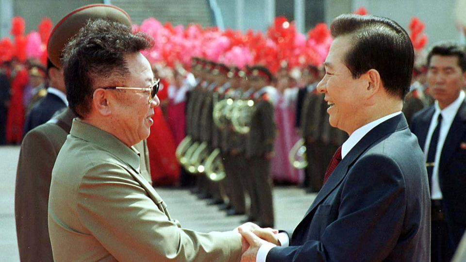 North Korean leader Kim Jong Il, left, and South Korean President Kim Dae-jung shake hands in Pyongyang, North Korea on June 13, 2000. (Yonhap Pool Photo via AP, File)