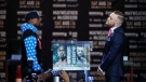 Conor McGregor, right, and Floyd Mayweather Jr. look at each other as they pause for photos during a news conference at Staples Center on Tuesday, July 11, 2017, in Los Angeles. The two will fight in a boxing match in Las Vegas on Aug. 26. (AP Photo/Jae C. Hong)