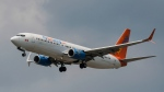 A Sunwing Boeing 737-800 passenger plane prepares to land at Pearson International Airport in Toronto on Wednesday, August 2, 2017. (THE CANADIAN PRESS/Christopher Katsarov)