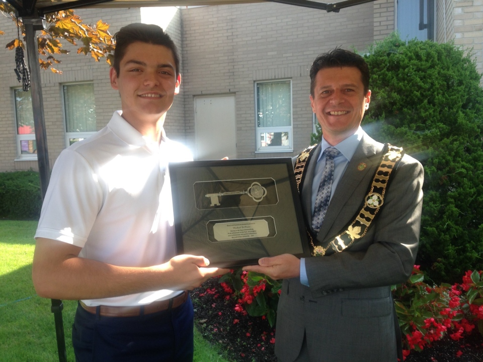18-year-old Michael DiPietro of Amherstburg receives the first ever key to the town from Mayor Aldo DiCarlo.(Bob Bellacicco/CTV Windsor)