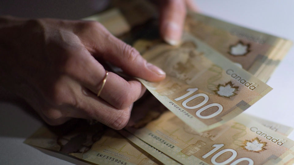Canadian $100 bills are counted in Toronto in a Feb. 2, 2016, file photo. (Graeme Roy/THE CANADIAN PRESS)
