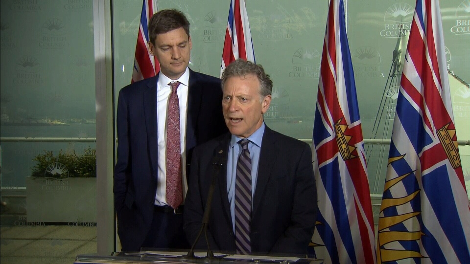B.C. Environment and Climate Change Strategy Minister George Heyman and Attorney General David Eby unveil the province's plan to fight the Trans Mountain pipeline expansion at a press conference in downtown Vancouver. Aug. 9, 2017.