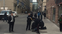 Police are seen arresting an assault suspect near Dundas and Church streets on Jan. 24, 2017. (Provided)