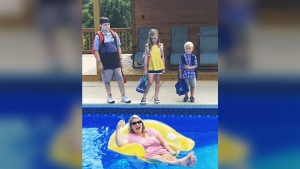 When her kids headed back to school, Alabama mom Jena Willingham snapped this photo of her lounging in the pool with a champagne flute of orange juice. The photo has since been shared thousands of times online. (Source: Jena Willingham, Facebook)