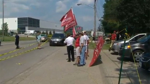 Union workers in Milton are seen protesting pension cuts.