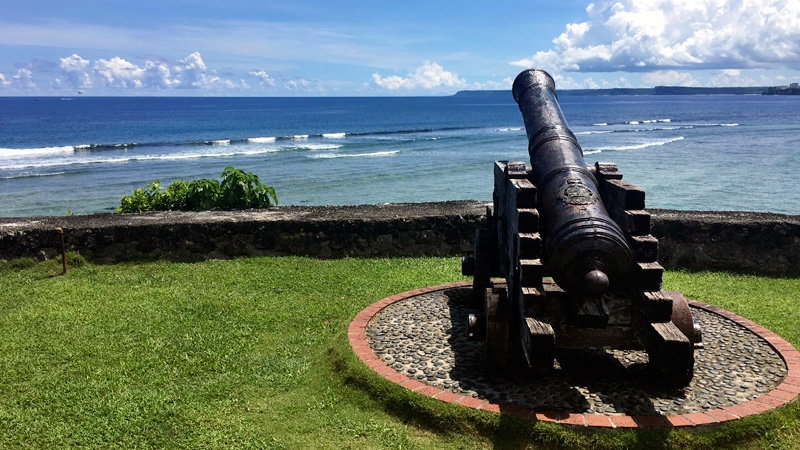 A replica of canons used by the Spanish from the Spanish occupation on Guam in the 19th century is seen outside of government offices in Hagatna, Guam on Friday morning, Aug. 11, 2017.  (AP /Tassanee Vejpongsa)