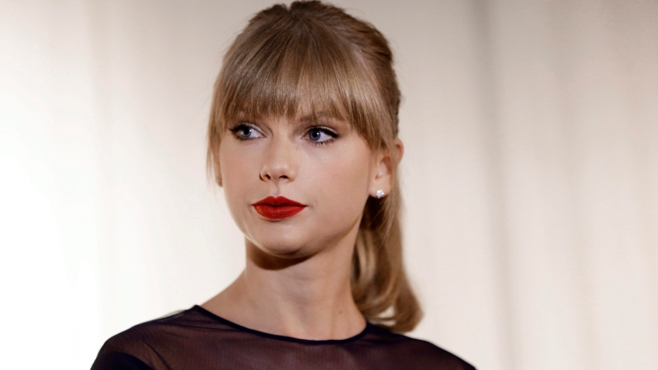 Taylor Swift appears at the Country Music Hall of Fame and Museum in Nashville, Tenn. on Oct. 12, 2013. (AP Photo/Mark Humphrey, File)