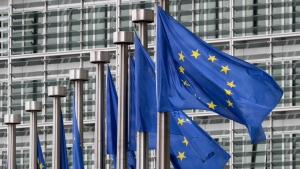 In this May 9, 2011 file photo, EU flags fly outside the European Commission headquarters in Brussels. (Yves Logghe/AP)