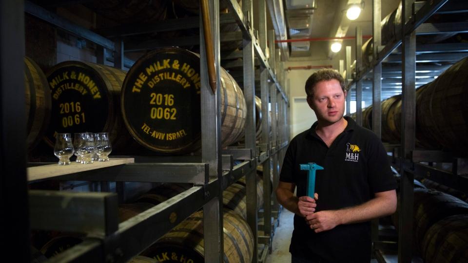 In this Thursday, Aug. 10, 2017 photo, Israeli Eitan Attir is seen in the barrels room at the 'Milk and Honey' whiskey distillery in Tel Aviv, Israel. (Sebastian Scheiner/AP)