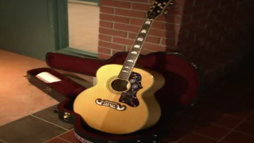 The acoustic guitar was stolen from Bravener's son's apartment more than a month ago.