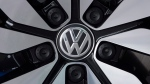 An e-Golf electric car with the VW logo on a rim is pictured in the German car manufacturer Volkswagen Transparent Factory (Glaeserne Manufaktur) in Dresden, eastern Germany. (AP Photo/Jens Meyer, file)