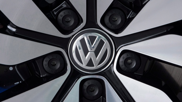3a20705e22 An e-Golf electric car with the VW logo on a rim is pictured in the German  car manufacturer Volkswagen Transparent Factory (Glaeserne Manufaktur) in  Dresden ...