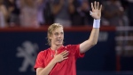 Denis Shapovalov of Canada salutes the crowd after defeating Rafael Nadal of Spain during round of sixteen play at the Rogers Cup tennis tournament Thursday August 10, 2017 in Montreal. (Paul Chiasson/The Canadian Press)