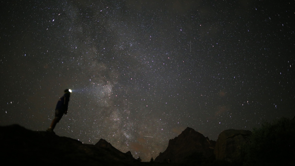 A photographer prepares to take pictures of the annual Perseid meteor shower in the village of Crissolo, near Cuneo, in the Monviso Alps region of northern Italy, on August 13, 2015. (Marco Bertorello/AFP)