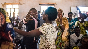 In this June 7th, 2017 photo provided by Alex Buisse, students, family and friends celebrate after the first class of the Southern New Hampshire University and Kepler higher education program graduated in Kiziba Refugee Camp in Kigali, Rwanda. (Alex Buisse via AP)
