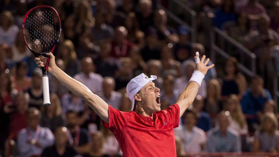 Denis Shapovalov celebrates after defeating Adrian Mannarino in the quarter-finals of the Rogers Cup on Friday August 11, 2017. THE CANADIAN PRESS/Paul Chiasson