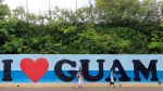 Tourists walk along a shopping area in the city of Tamuning on the island of Guam. (Virgilio Valencia/AFP)