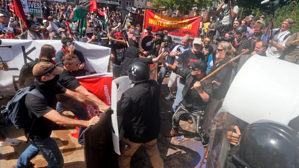 White nationalist demonstrators clash with counter demonstrators at the entrance to Lee Park in Charlottesville, Va., Saturday, Aug. 12, 2017. (Steve Helber/AP)