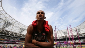 Canada's Damian Warner listens to his coach in a break in the Decathlon shot put during during the World Athletics Championships Friday, Aug. 11, 2017.(Tim Ireland/AP Photo)