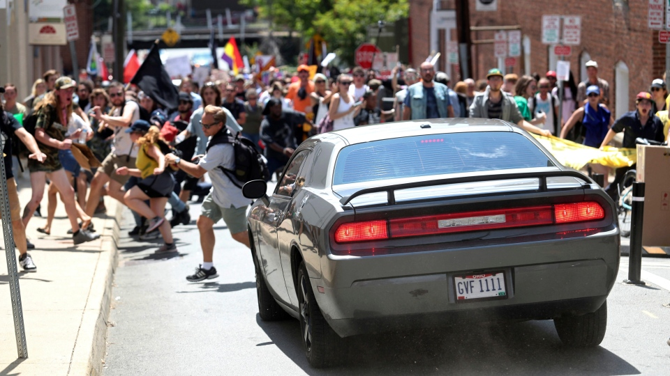 A vehicle drives into a group of protesters demonstrating against a white nationalist rally in Charlottesville, Va., Saturday, Aug. 12, 2017. (The Daily Progress via AP)