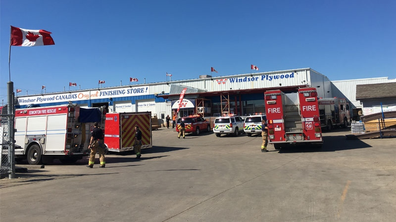 Edmonton police and fire crews rescued two employees who were pinned underneath shelves of lumber on Saturday, August 12, 2017.