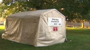 A tent containing naloxone kits and injection implements is seen in Moss Park on Aug. 12, 2017. (CP24)