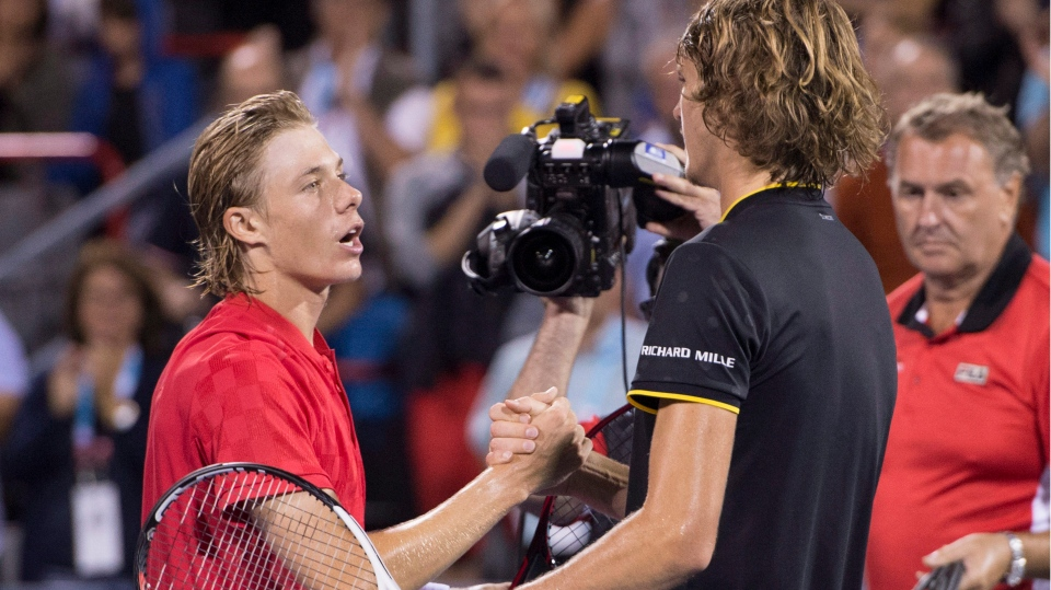 Denis Shapovalov of Canada congratulates Alexander Zverev of Germany after winning the semifinal at the Rogers Cup tennis tournament Saturday August 12, 2017 in Montreal. THE CANADIAN PRESS/Paul Chiasson