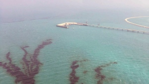 This Saturday Aug. 12, 2017 photo released by Kuwait Environment Public Authority, shows an oil spill near Kuwait's southern Ras al-Zour in Persian Gulf waters. (Kuwait Environment Public Authority via AP)