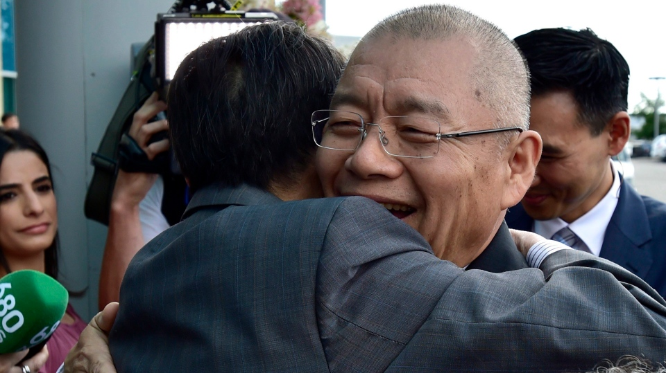 Pastor Hyeon Soo Lim (right) is hugged as he arrives at the Light Presbyterian Church in Mississauga, Ont., Sunday, August 13, 2017. (Frank Gunn / THE CANADIAN PRESS)