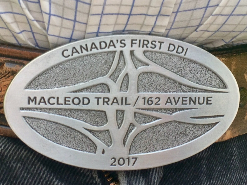 Belt buckles were presented to construction workers during the ceremonial opening of the 162 Avenue - Macleod Trail DDI on August 13, 2017